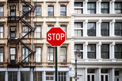 Stop Sign in front of Old Buildings in New York City Stock Images