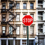 Stop Sign in front of Old Buildings in New York City Royalty Free Stock Photography