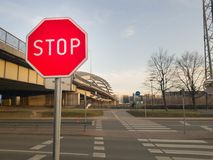 Stop sign in front of road crossing royalty free stock photography