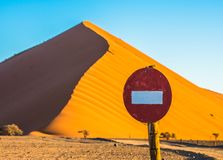 Stop sign in front of sand dune in Sossusvlei, Namib-Naukluft Na. Tional Park, Namibia Stock Photos