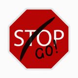 Stop sign with go Stock Photo