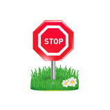 Stop sign and grass isolated on white Royalty Free Stock Photos