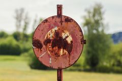 Stop sign in green fields Stock Photo