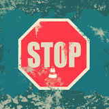 Stop  sign  on  grunge background Royalty Free Stock Photos