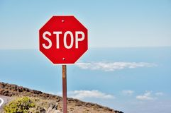 Stop sign  above clouds. There is stop sign in the area of volcano   in  Haleakala National park in Maui  , amazing to see the sign like this above clouds on Royalty Free Stock Photo