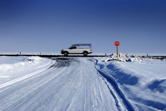 Stop Sign at Intersection in Winter Snowy Road. Stop sign at intersection in Winter on a snowy road Stock Image
