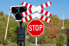 Stop sign and light rail on an autumn trees background Royalty Free Stock Photography