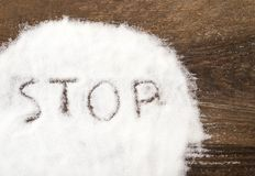 Stop sign made of granular sugar. The picture illustrates the harm of eating sugar and salt, as well as dependence on flavoring additives Stock Photos