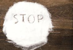 Stop sign made of granular sugar. The picture illustrates the harm of eating sugar and salt, as well as dependence on flavoring additives Stock Photography