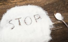 Stop sign made of granular sugar. The picture illustrates the harm of eating sugar and salt, as well as dependence on flavoring additives Royalty Free Stock Images