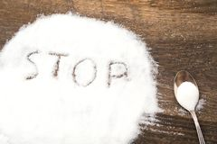 Stop sign made of granular sugar. The picture illustrates the harm of eating sugar and salt, as well as dependence on flavoring additives Stock Photo