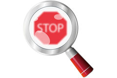 Stop sign magnifying glass Stock Photos