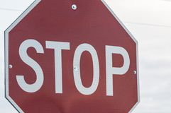 Stop sign. In the middle of the road royalty free stock images