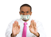 Stop sign with money taped to mouth Stock Photo