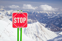 Stop sign in mountains Royalty Free Stock Images