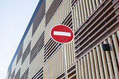 Stop sign near new parking building, empty street nobody concept Stock Photos