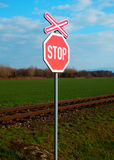 Stop sign near the railway track Royalty Free Stock Photos
