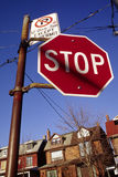 Stop Sign In Neighborhood. Close-up shot of a stop sign in a residential neighborhood Stock Photo