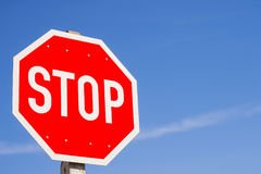 Stop Sign. Octagon shape stop sign against blue sky Stock Image