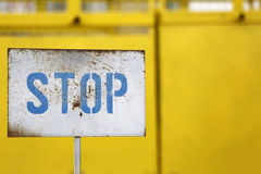 Stop sign on old metal panel Stock Photography