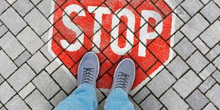 Free STOP Sign On Concrete Pavement Royalty Free Stock Photography - 182931797