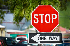 Stop sign. Stop and one way sign on a street royalty free stock photography