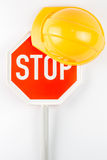 Stop sign and orange safety helmet Royalty Free Stock Photography