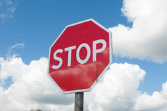 Stop sign over blue sky background Stock Photo