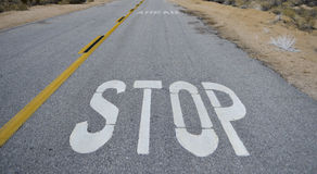 Stop Sign. Painted on a desert road Stock Photos