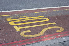 Stop sign painted on the road in London Royalty Free Stock Image