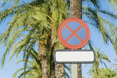 Stop Sign and Palms on a Blue Sky Stock Photos