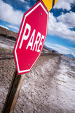 Stop sign (pare) at railway crossing in a desolate landscape royalty free stock photo