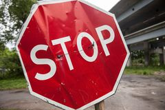 Stop sign with partly bent surface Stock Image