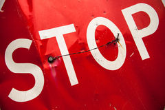 Stop sign with partly bent surface Royalty Free Stock Images