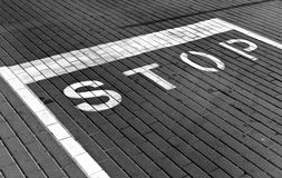 Stop sign on pavement in black and white Stock Photos