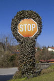 Stop sign with plants Stock Image