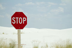 Stop Sign at the Beach. A stop sign post at the beach. white sand in the background Royalty Free Stock Photo