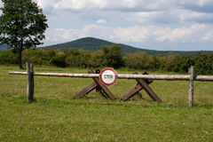 A stop sign posted at Checkpoint Alpha in East Germany in Russian. A stop sign locatedat Checkpoint Alpha in East Germany in Russian language Stock Images