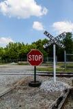 Stop Sign at Railroad Crossing Royalty Free Stock Photos