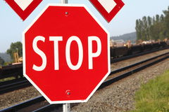 Stop Sign by Railroad Crossing Stock Photos