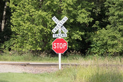 A Stop Sign at a Railroad Crossing Royalty Free Stock Photo