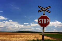Stop Sign on railway. On blue sky Royalty Free Stock Photography