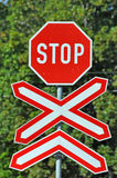 Stop sign at railway crossing Stock Images