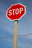 Stop Sign and Razor Wire Stock Images