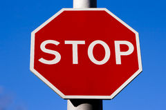 Stop sign. Red stop sign on the blue sky Stock Photos