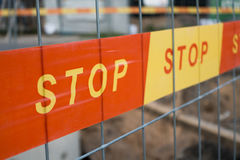 Stop sign ribbon on the construction site Stock Photography