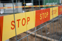 Stop sign ribbon on the construction site Royalty Free Stock Images