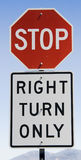 Stop Sign and Right Turn Only. Combination stop and Right Turn Only sign against a blue sky royalty free stock images
