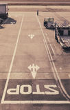 Stop sign on Road ,Airport runway with Truck Royalty Free Stock Photography