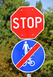 Stop sign at the road crossing Royalty Free Stock Images